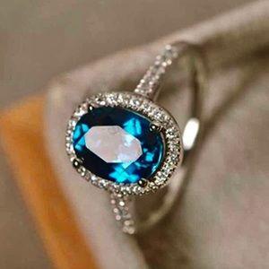 London Blue Topaz White Sapphire Halo Ring 6-7